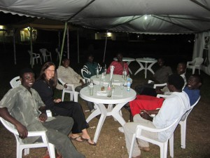 Glenda sitting with Hopethiopia sponsored young adults. These men are now receiving educational and microfinance assistance