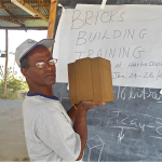Shife shows off the very first ever Hydraform buck produced by our brick building team at our project site in Harbhu Chulule,