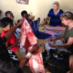 A group of sponsored women check out the gifts that have been brought
