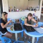 Vanessa and Diane work hard on preparing seedlings for the garden projects. It was amazing at how fast they grew.