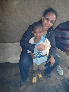 Selam gives a big hug to Abiti, a 1 1/2 year old boy that is sponsored by Hopethiopia. His sister, Sintayo, is featured in the 2013 Hopethiopia charity calendar (April)