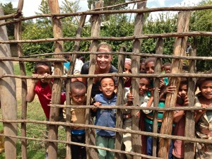 Looking through a fence at one of the sponsored family homes