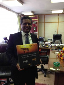 President Bekalu of the Commercial Bank of Ethiopia enjoys his copy of the Charity calendar