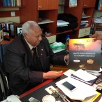 Ret. President Girma of Ethiopia enjoys his copy of the 2014 Charity Calendar