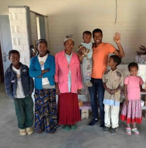 The family stands with Gadisa (Hopethiopia team member in charfe of Women's and Children's affairs)