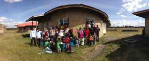 A number of the families gather in front of Home #1 at the Children's village